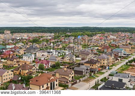 Perm, Russia - June 21, 2020: Private Houses In A Suburban Neighborhood At The Edge Of The Forest, T