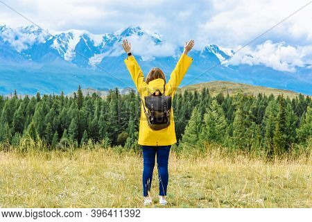 Woman Traveler In A Mountain Landscape. Travel And Active Life Concept. Adventure And Travel In The