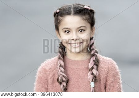 Girl With Cute Face Smiling Outdoors. Beautiful Hairstyle. Fashionable Hairstyle For Kids. Small Gir