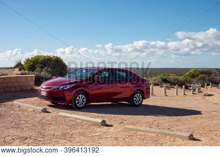 Western Australia - July 4, 2018: Shiny Toyota Corolla Sedan Rental Vehicle Parked In Deserts Of Wes