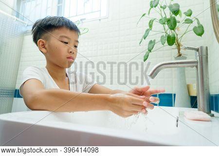Boy Wash His Hand On A Bath