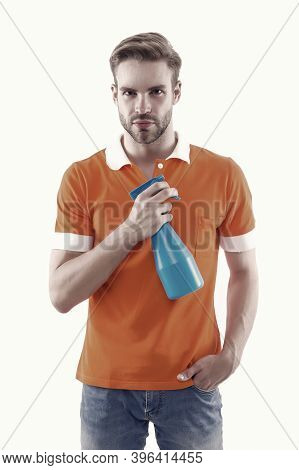 Keep Your House Dust-free. Handsome Man Hold Hygiene Spray Bottle. Disinfectants And Antibacterials