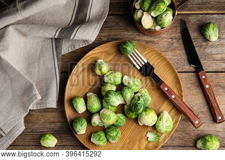 Fresh Brussels Sprouts On Wooden Table, Flat Lay