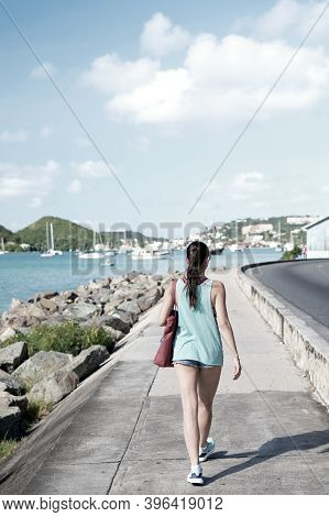 Sexy Woman Walk Along Sea In St.thomas, British Virgin Island. Woman In Top And Shorts On Sea Side P