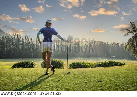 Golfer Woman Playing Golf People Swing And Hitting Golf Course Is On The Fairway. Hobby In Holiday A