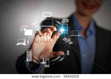 Business person pushing symbols on a touch screen interface