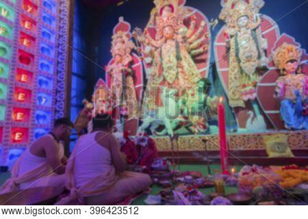 Blurred Image Of Hindu Bengali Purohits Chanting Sanskrit Shlokas In Durga Puja For Worshipping Godd
