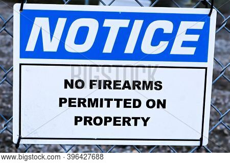 A Notice, No Firearms Permitted On Property Sign