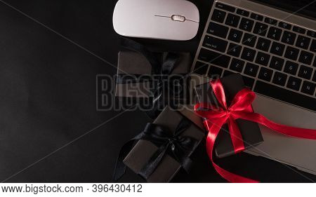 Black Friday Sale Online Shopping Commerce, Top View Of Gift Box Wrapped Black Paper And Red Bow Rib