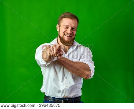 Hey, You. The Man Shows His Fingers In The Frame On A Green Background. Youre A Winner. Caucasian Wi