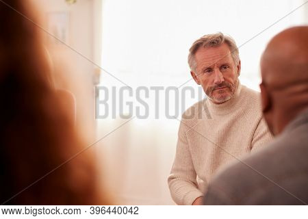 Mature Man Attending Support Group Meeting For Mental Health Or Dependency Issues In Community Space
