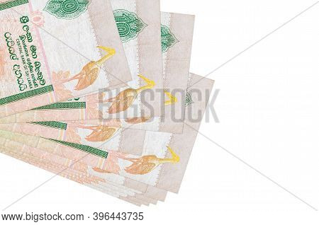 10 Sri Lankan Rupees Bills Lies In Small Bunch Or Pack Isolated On White. Mockup With Copy Space. Bu