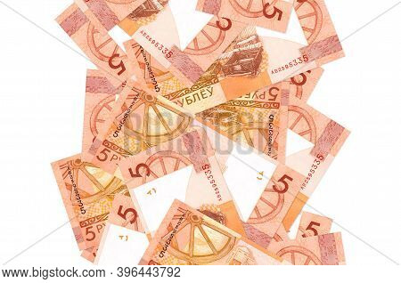 5 Belorussian Rubles Bills Flying Down Isolated On White. Many Banknotes Falling With White Copyspac