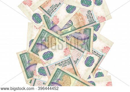 1000 Sri Lankan Rupees Bills Flying Down Isolated On White. Many Banknotes Falling With White Copysp