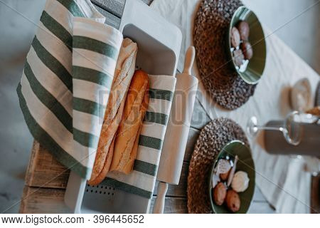Festive Table Christmas Decorations. Dishes With Christmas Gingerbread Cookies And Hot Bread In The