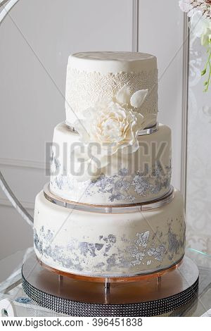 The White Wedding Cake With Beautiful Decorations