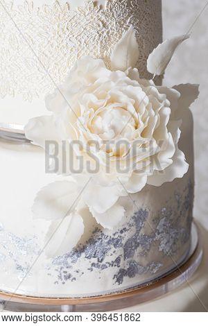 The Charming Sugar Decorations On A Wedding Cake