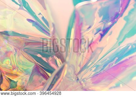 Iridescent Blurred Holographic Texture. Colorful Foil Wrinkled Material.