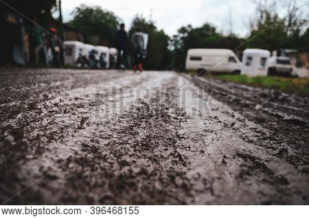 Shallow Depth Of Field (selective Focus) Image With The Mud On An Unpaved Road During A Rainy Summer