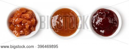 set of glass bowl with jam isolated on white background