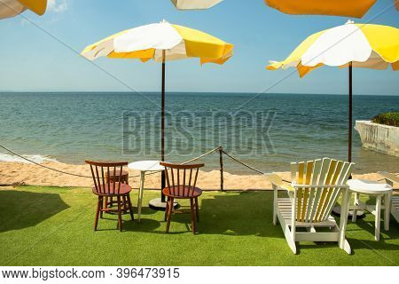 Summer Travel Trip Concept : Tropical View Of Wooden Beach Chair And Umbrella On Seashore With Seasc