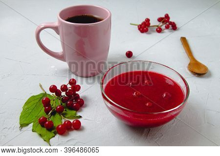 Autumn Composition With Viburnum Jam, Viburnum Branches And Leaves, White Linen Towel, Pink Cup, And