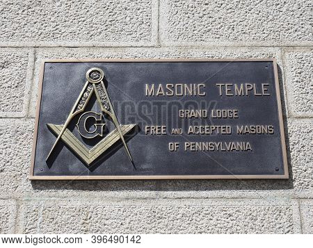 Philadelphia, Usa - June 11, 2019: Image Of The Bronze Sign With The Emblem Of The Freemasons On One