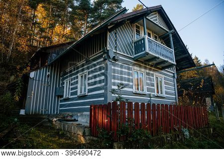Small Gray House, Old Wooden Timber Hut With A Fence, Cottage Surrounded By Trees, Bohemian Paradise