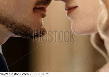 A Man And A Woman On The Eve Of A Kiss, Lips Of A Heterosexual Couple Close Together. Parts Of The F