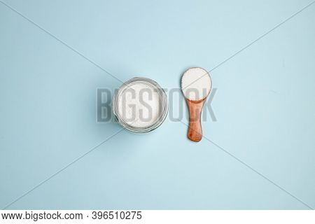 Collagen Powder Or Protein In A Glass Bowl And Small Wooden Spoon On Beige Coral Background With Cop