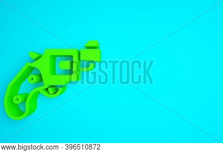 Green Small Gun Revolver Icon Isolated On Blue Background. Pocket Pistol For Self-defense. Ladies Re