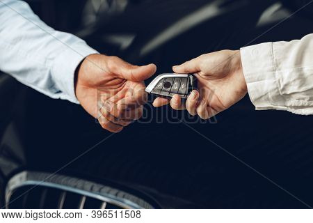 Car Salesperson Giving Keys To A Client Close Up