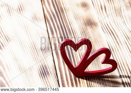 Two red wooden hearts symbol of love on wood background, Saint Valentine Day celebration