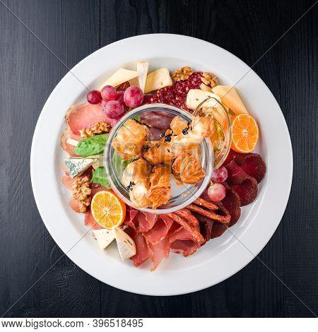 Antipasto Delicatessen - Sliced Meat, Ham, Salami, Cheese, Olives On Dark Table, Anti-paste Top View