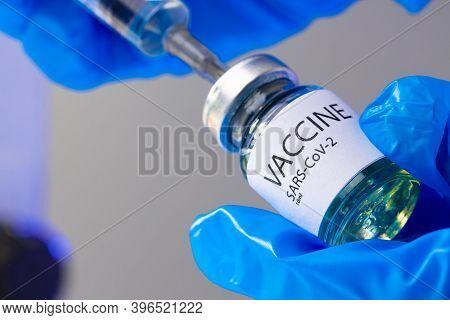 Covid-19 Vaccine Bottle With A Syringe Taking The Vaccine From It