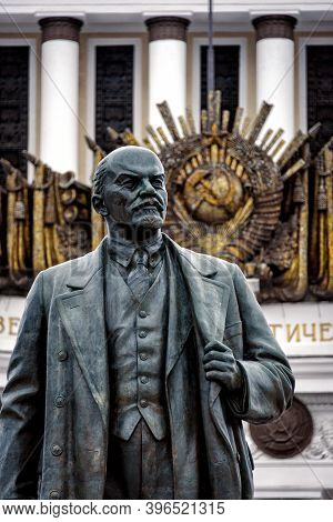 Moscow, Russia - 02 14 2014: Statue Of Lenin With The Golden Soviet Sickle And Hammer In The Backgro