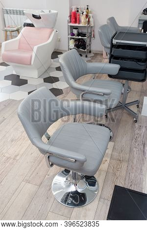 Workplace For Haircut In Barbershop, With Backlit Mirror