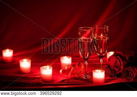 Valentines day background with champagne glasses roses candles and hearts