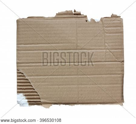 Piece Of Corrugated Cardboard Isolated On A White Background. Brown Cardboard With Ragged Edges.