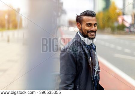 Portrait of a handsome young man on the city street