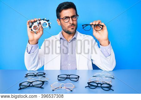 Young hispanic man with optometry glasses skeptic and nervous, frowning upset because of problem. negative person.