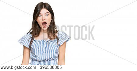 Young beautiful caucasian girl wearing casual clothes afraid and shocked with surprise and amazed expression, fear and excited face.