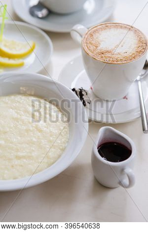 Bowl Of Oatmeal Porridge Served With Coffee