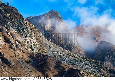 Rocks And Clouds In North Caucasus Mountains In Autumn On Sunny Day