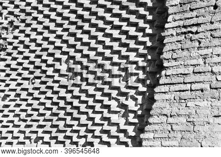 Bricks Arranged Differently In Two Walls, One Staggered That Draw Zigzag And Oblique Lines And The O