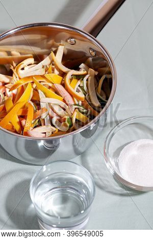 Sliced Citrus Fruit Peel For Cooking Candied In A Stainless Saucepan. Concept Reducing Food Waste