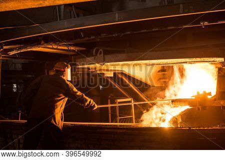 Steelworker When Pouring Liquid Metal From Arc Furnace