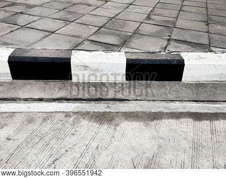 Close Up Of Black And White Concrete Curb, Sidewalk Curb.