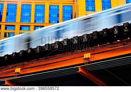 The L train subway line in Chicago blurry motion with apartments in background