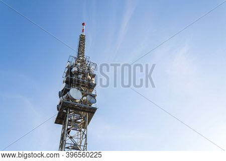 Telecommunication Tower With Transmitters And Aerials, Wireless Communication And 5G Broadband Cellu
